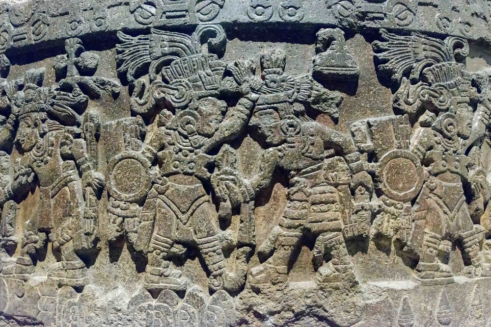 Relief depicting a procession of warriors.
