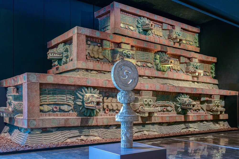 """Detail of the pyramid of the Feathered Serpent, showing the alternating """"Tlaloc"""" (left) and feathered serpent (right) heads."""