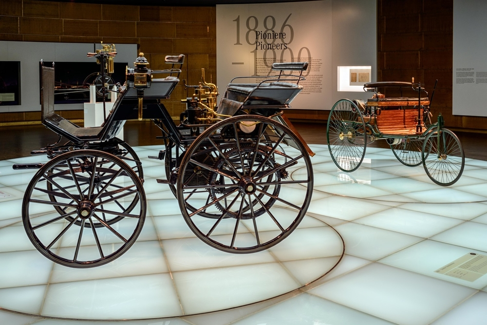"""Daimler Motorkutsche"",  1886. The Daimler motorized carriage, the worlds first four-weeled automobile.  In the back is the  ""Benz Patent Motor Car"" , the world's first gasoline-engined automobile."