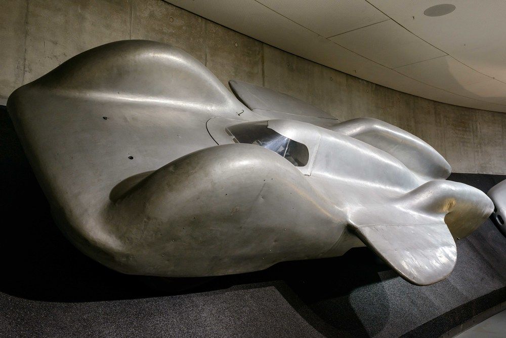Mercedes-Benz T 80 world record car.   Designed by Ferdinand Porsche, powered by the DB 603 aero engine and developing 3,000 hp: The T 80 was to become the world's fastest car on four wheels and reach a speed of 373 mph on the motorway near Dessau in early 1940. However, the outbreak of World War II prevented the car from being completed, and the T 80 never hit the road.