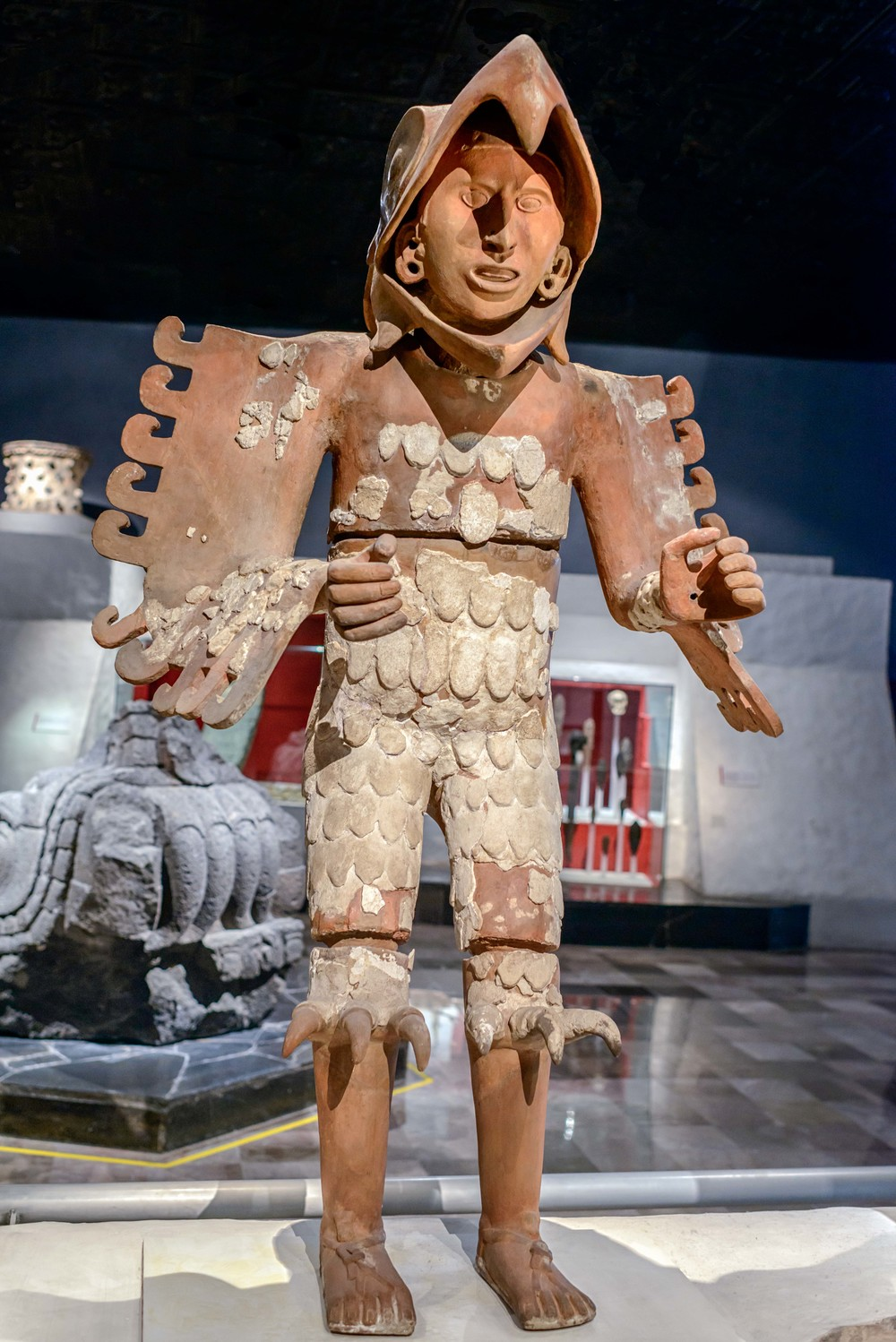Natural size ceramic sculture representing an Eagle Warrior. Templo Mayor Museum, Mexico City.
