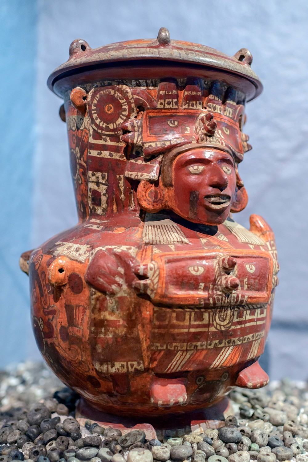 Chicomecoatl. This ceramic vase, decorated in a polychrome Cholula style, presents an image of Chicomecoatl: its cover shows Tlaloc, god of rain, pouring water. Templo Mayor Museum, Mexico City.