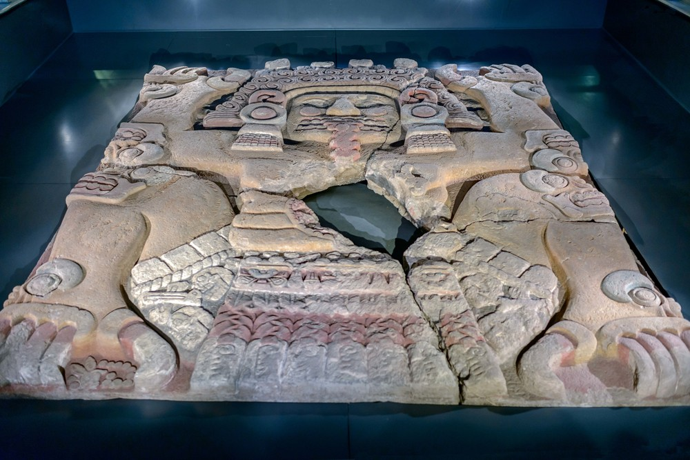 Earth goddess Tlaltecuhtli, found 2006 l ocated at the foot of the steps of the Great Temple. The monolith, despite being broken into four main parts, is preserved in excellent condition with a human face, clawed hands and feet, and labouring position. Templo Mayor Museum, Mexico City.