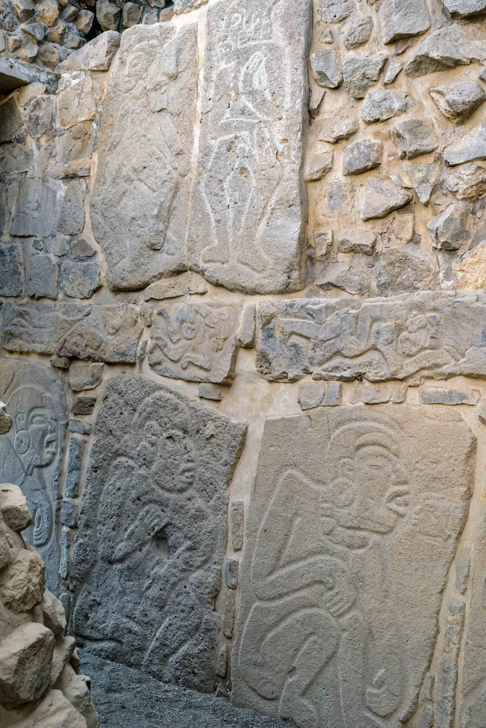 Inside Temple of the Dancers are further reliefs of danzantes, Monte Alban,  Oaxaca, Mexico.