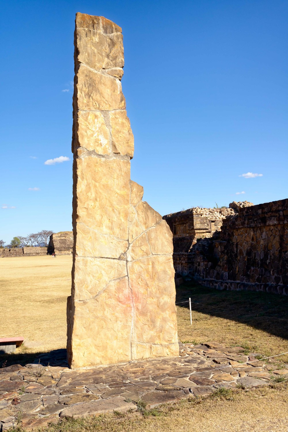 Stele 18 is the oldest and tallest (5.8 meters) found. It is believed that it was an astronomical instrument. On the eastern side are two glyphs, one a water sign. Incisions on the western side may relate to a calendar, Monte Alban,  Oaxaca, Mexico.
