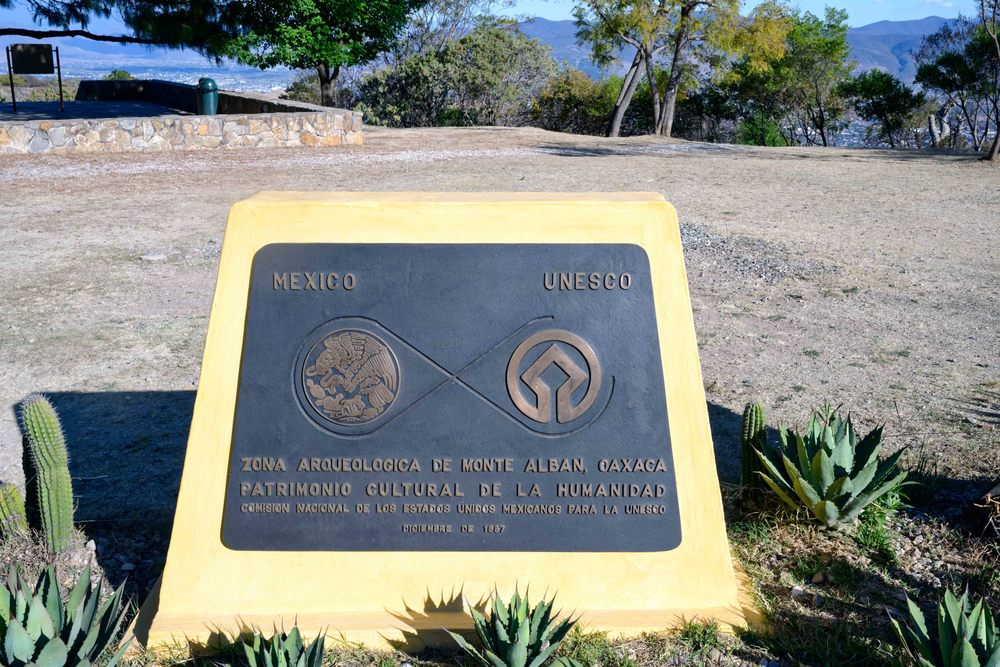 UNESCO sign from December 1987 at the entrance to the site, Monte Alban,  Oaxaca, Mexico.