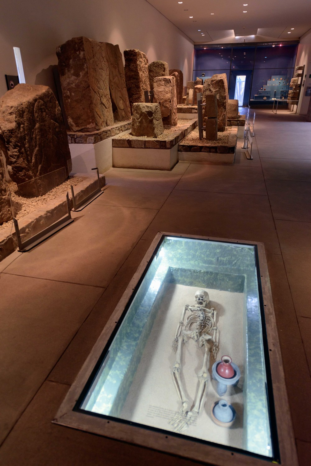 Steles collection and burial practices of the Zapotecs from the site museum at Monte Alban, Oaxaca, Mexico.