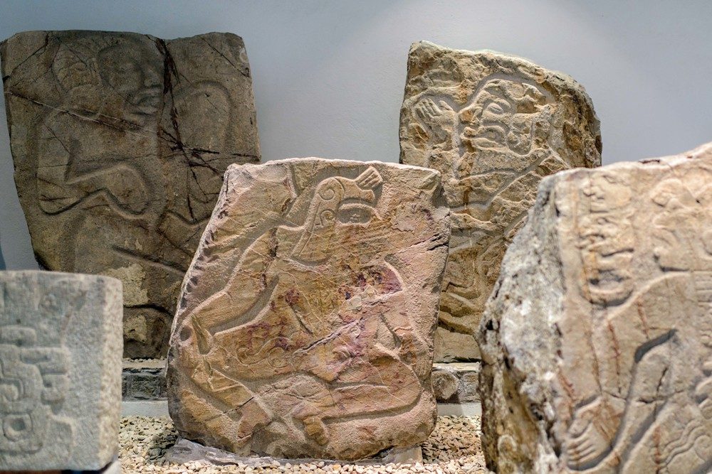 "Engraved steles collection with ""danzantes"" (dancers) within the site museum at Monte Alban, Oaxaca, Mexico."