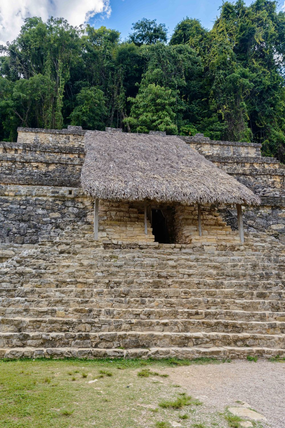 Part of the  Temple of the Inscriptions  with the a passageway leading through a long stairway to  Pakal's tomb .