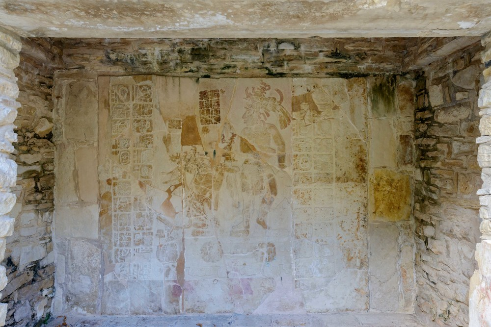 The  bas-relief carvings  reveal Chan Bahlum receiving the great gift from his predecessor. The cross motif found at the complex allude to the names given to the temples, but in reality the cross is a representation to the World Tree   that can be found in the center of the world according to Mayan mythology.