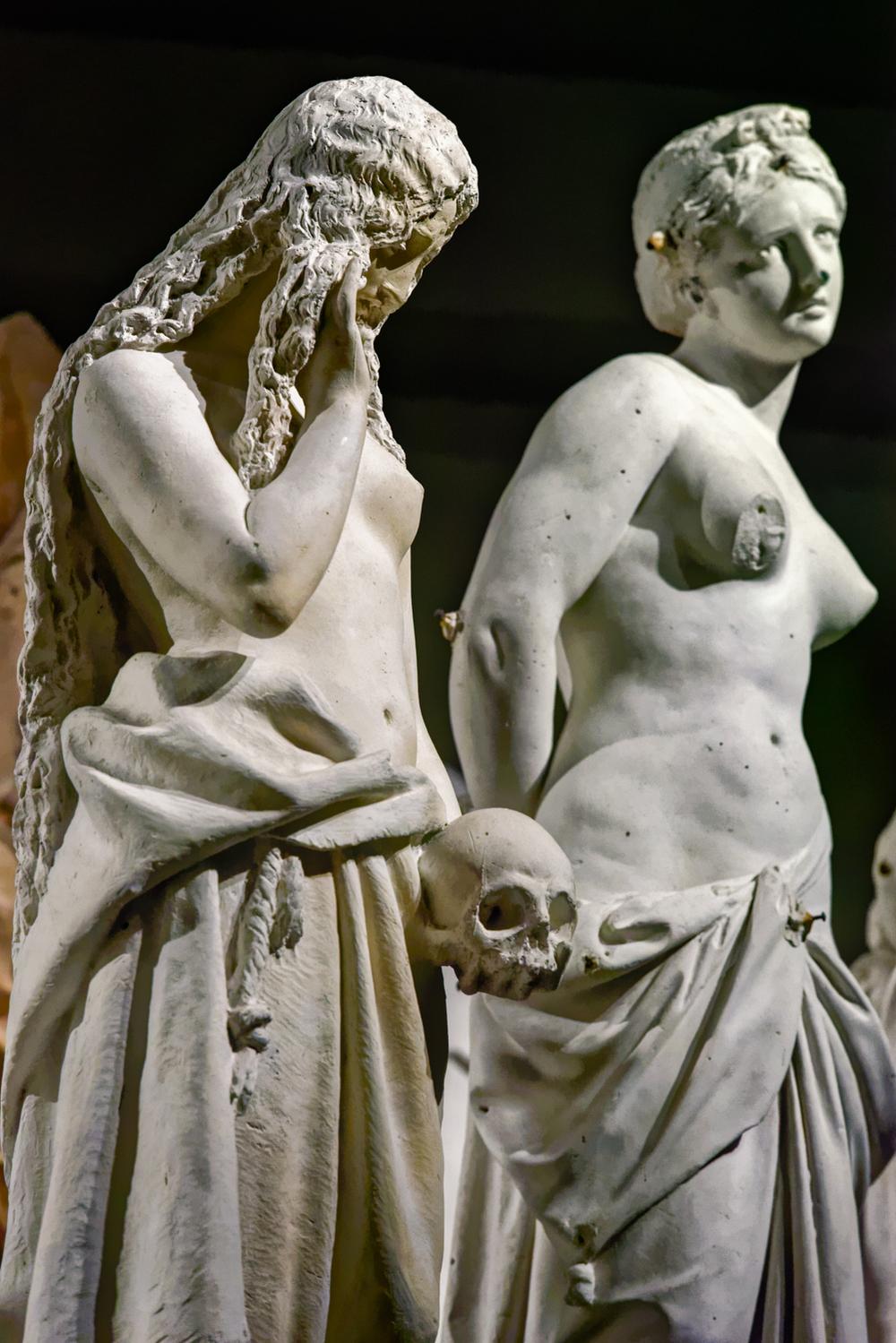 Left:  Penitent St. Magdalene  (Giosuè Argenti, 1864-1865), Right:  St. Agatha  (Giovanni Pandiani, 1866). Plaster. Duomo di Milano, Museum.