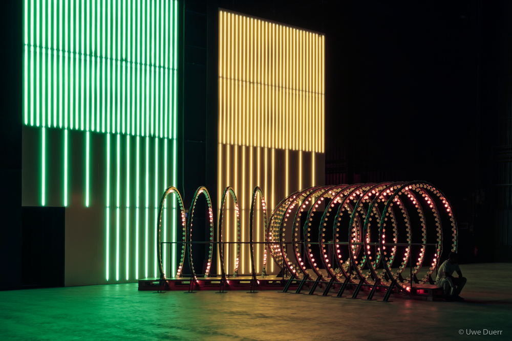 "Carsten Höller - ""Doubt"" Exhibition.  In the front:  ""Y""  (2003); incandescent light  bulbs, digital controllers, aluminium, illuminated signs at both exits, wood, steel, mirrors.  At the back:  ""Division Walls""  (2016); neon tubes, Alucobond, aluminium, transformers."