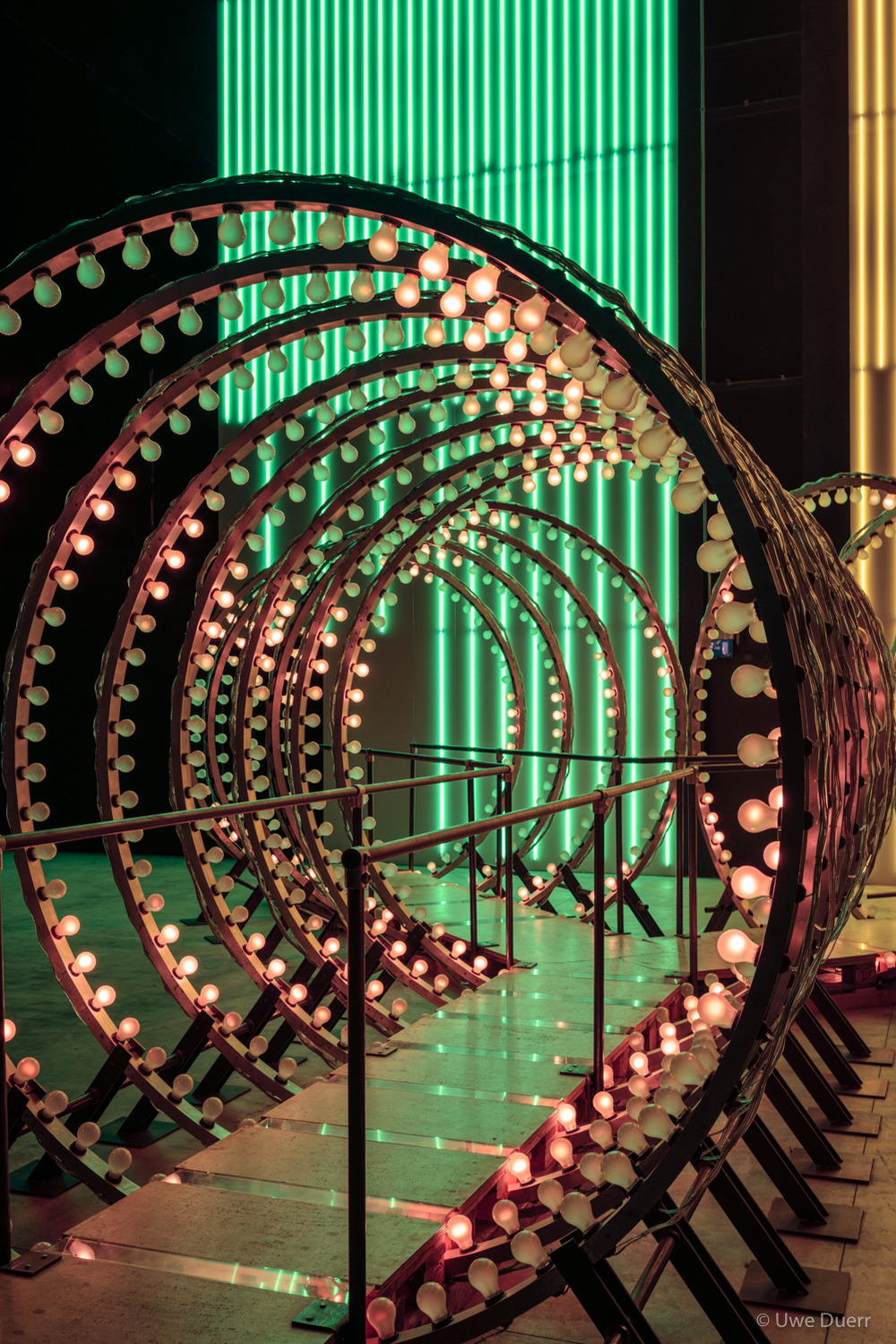 "Carsten Höller - ""Doubt"" Exhibition.   ""Y""  (2003); incandescent light  bulbs, digital controllers, aluminium, illuminated signs at both exits, wood, steel, mirrors; 300 x 600 x 1200 cm. Thyssen-Bornemisza Art Contemporary, Vienna."