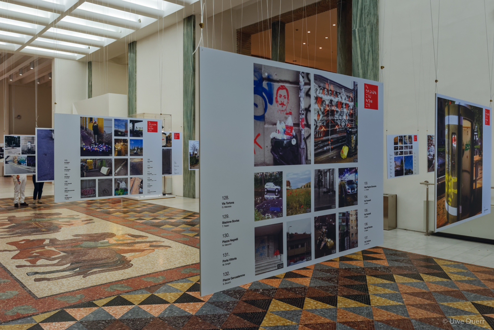 Photographs in front of the  Museum Store .  On the occasion of XXI International Exhibition of the Triennale, the library reopened completely renovated with the new concept by Studio Urquiola.