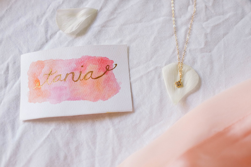 name cards and necklace