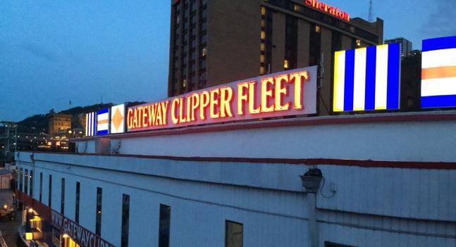 """Logo atop Gateway Clipper Fleet dock office. """"Flag"""" elements added in 2012."""