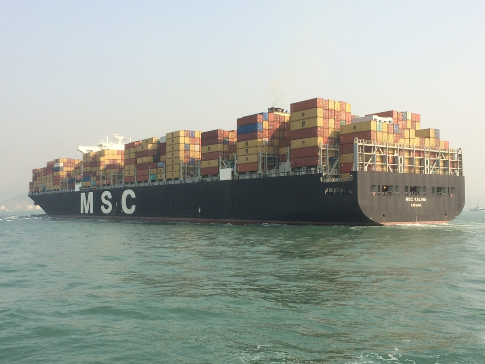 A container ship in Hong Kong harbor. I think I see our wine on there!
