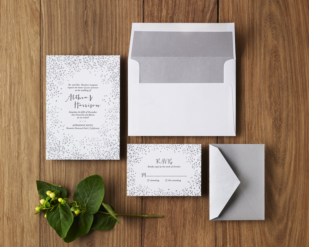 A holiday-time wedding doesn't have to include red! Try silver, gold or other metallics to summon the spirit of winter.