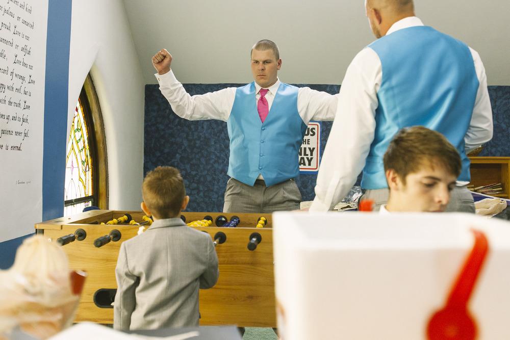 groomsmen-winning-foosbal.jpg