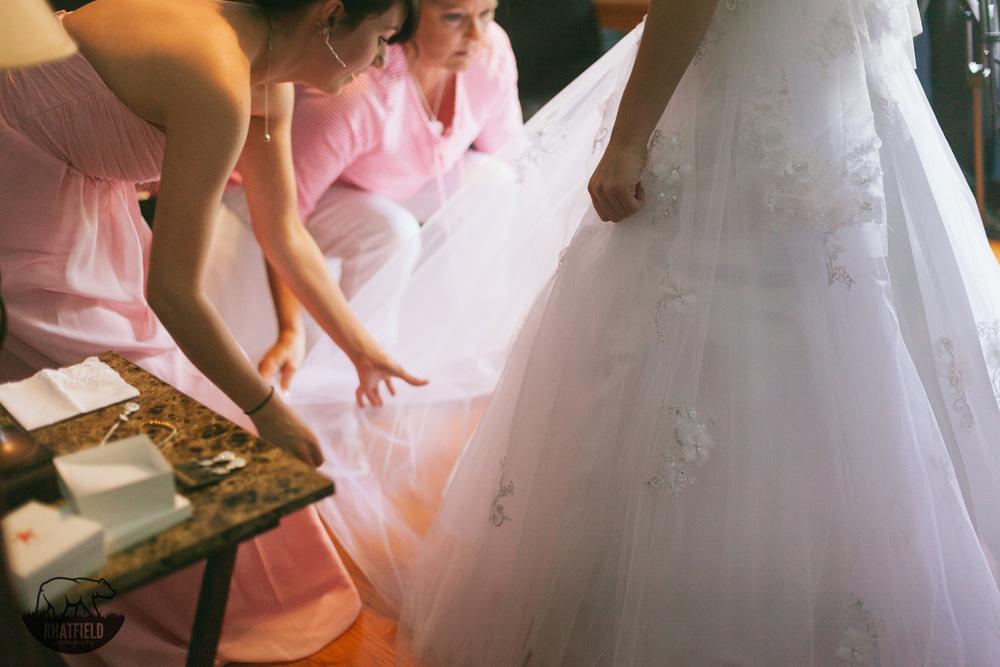 bride-fitting-wedding-dress