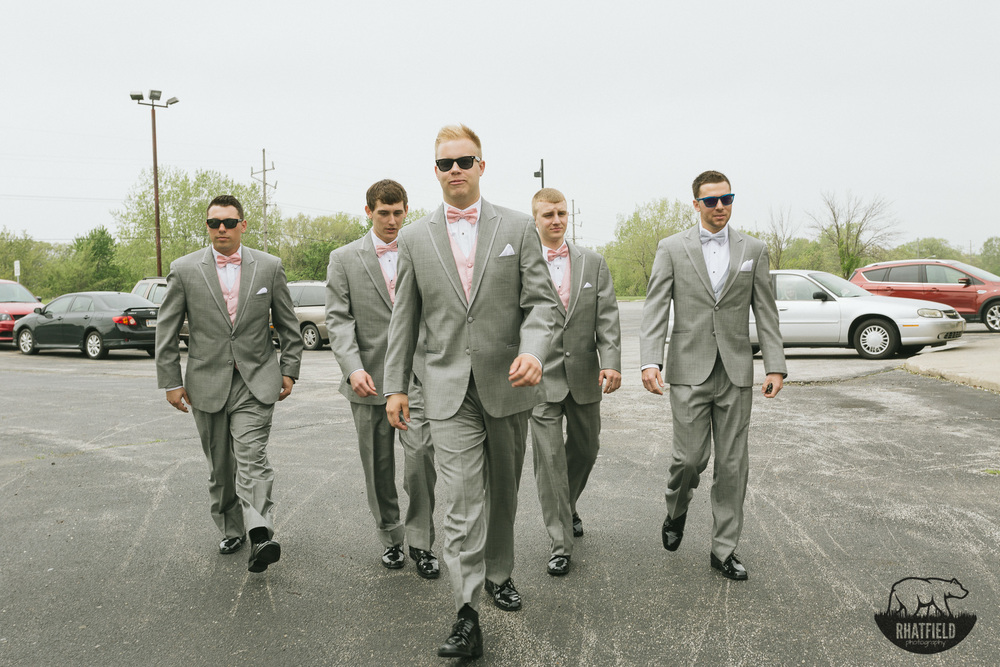 groomsmen-walking-church-sunglasses