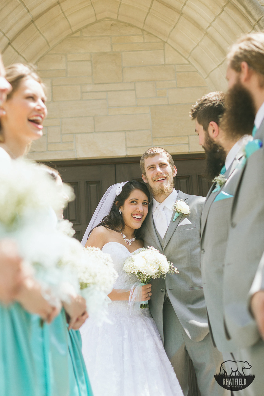 bridal-party-laughing-church-portrait