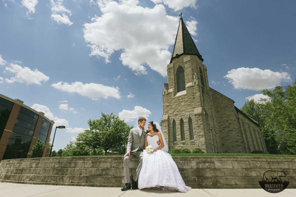 couple-clouds-blue-sky-church-wide