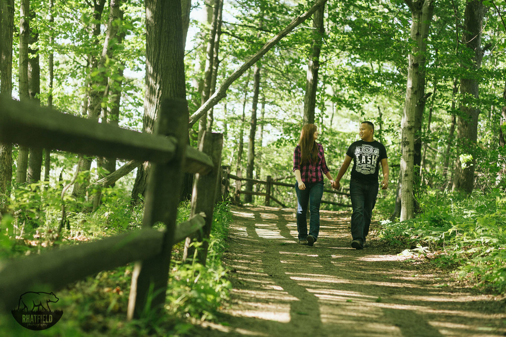 couple-walking-trail-woods