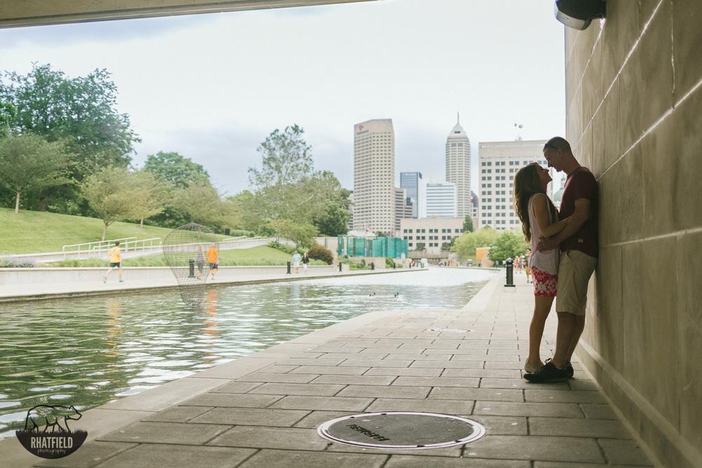 Couple-kissing-under-bridge-river-walk