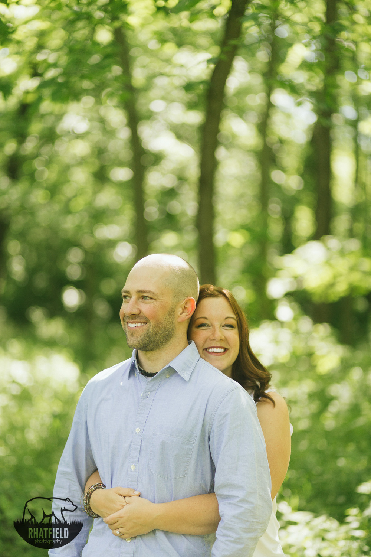 couple-hugging-portrait-woods