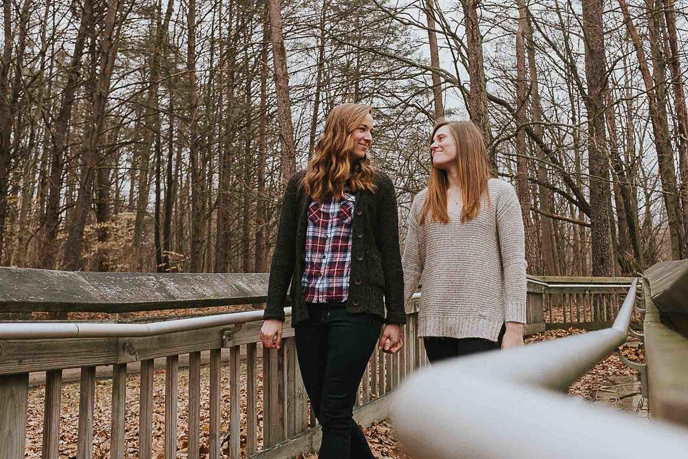 walking-holding-hands-woods-ramp