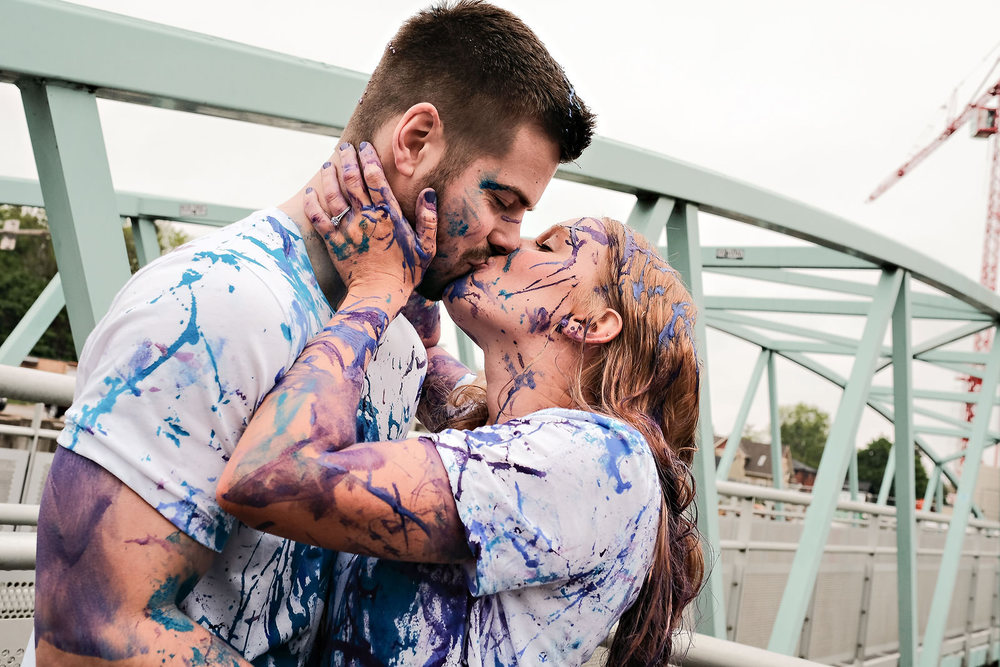 covered-in-paint-engagement-kiss