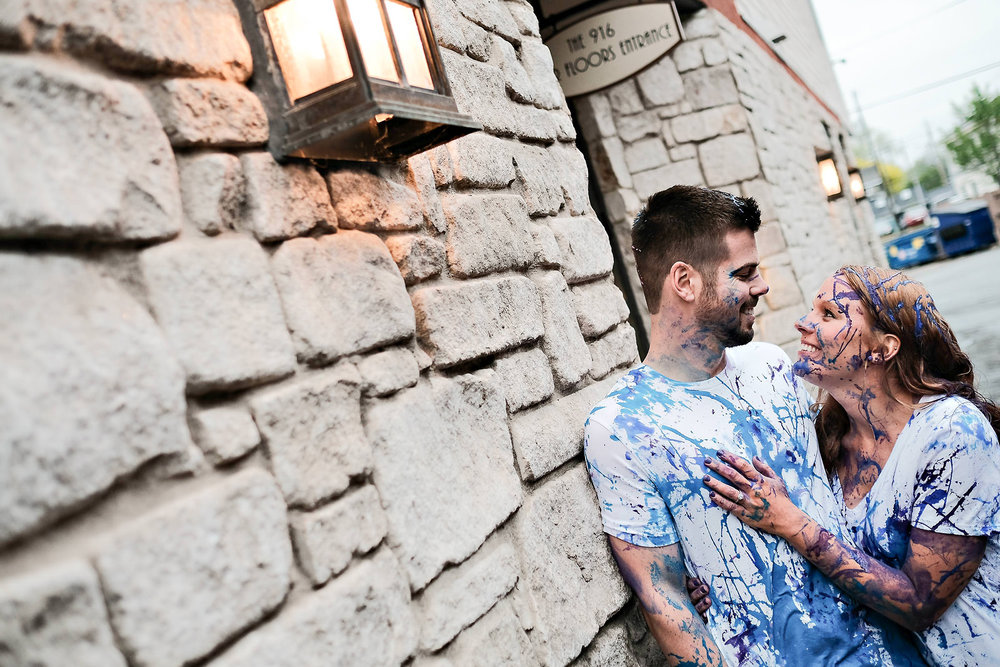 white-brick-stone-wall-couple-portrait