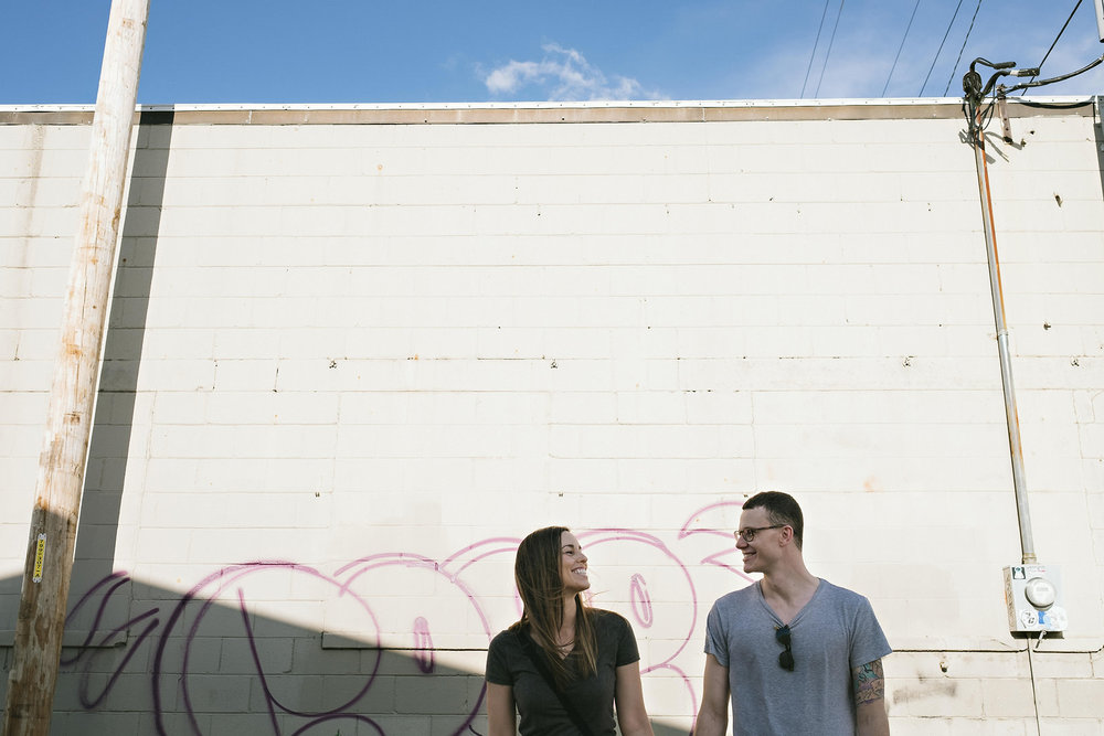 graffiti-wall-white-brick-couple
