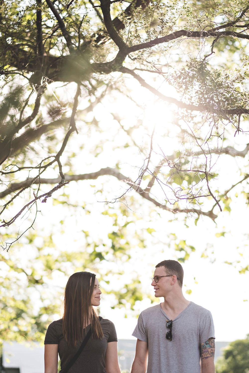 engaged-couple-under-beautiful-green-tree