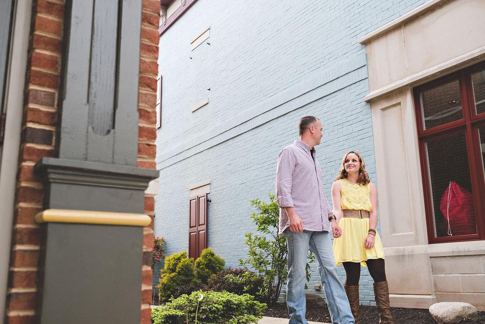 couple-holding-hands-carmel-indiana-blue-brick