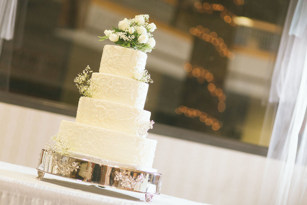 unique detailed white 4 tier wedding cake