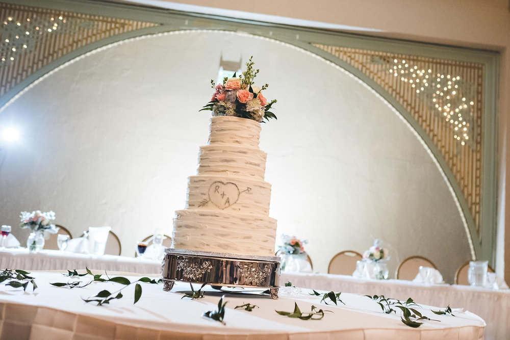 beautiful florial toped white modern wedding cake