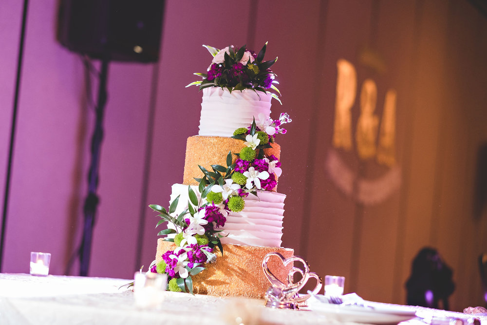 unique modern white and gold cascading floral purple wedding cake