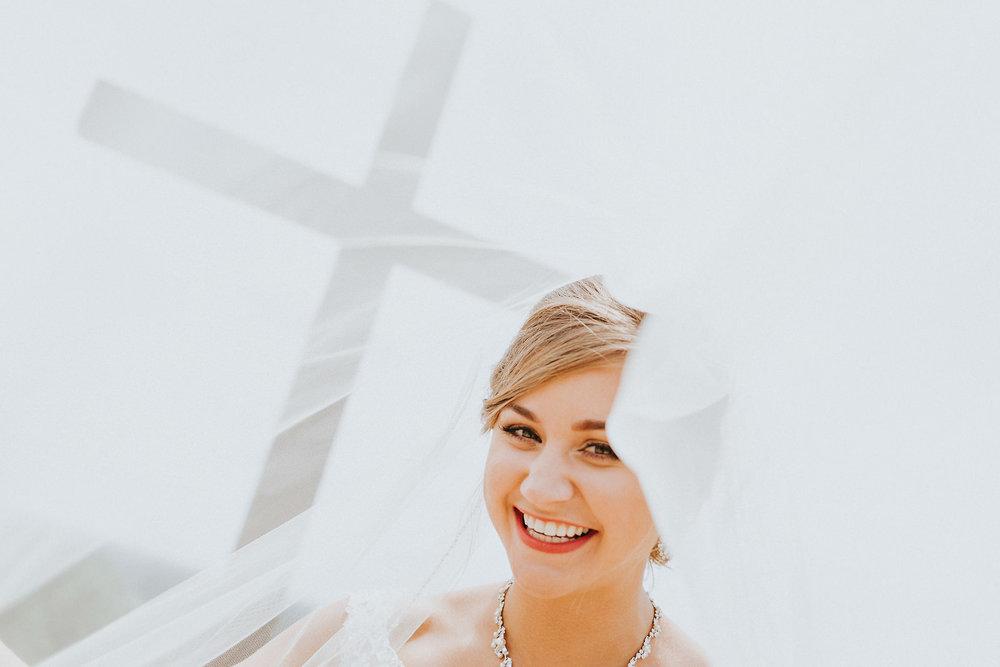 Smiling bride under veil