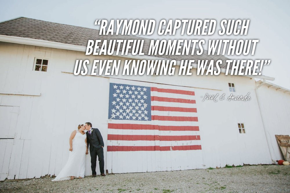 Married couple kissing in front of american flag wedding barn.jpg