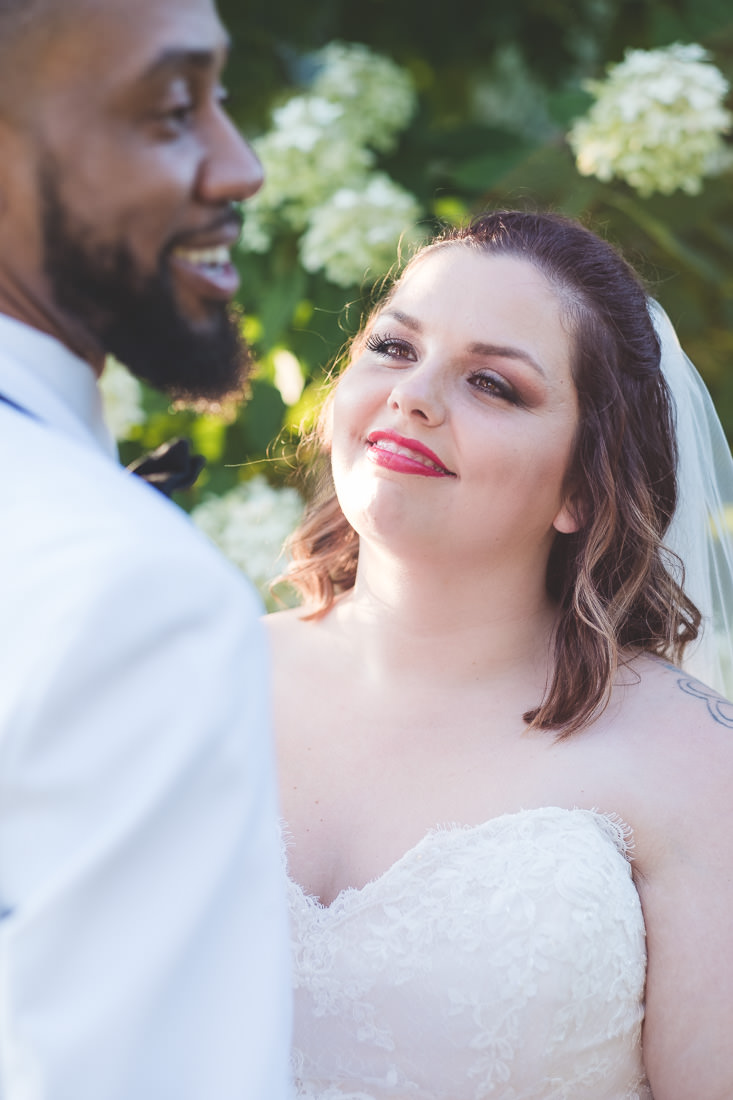 bride-smiling-at-groom