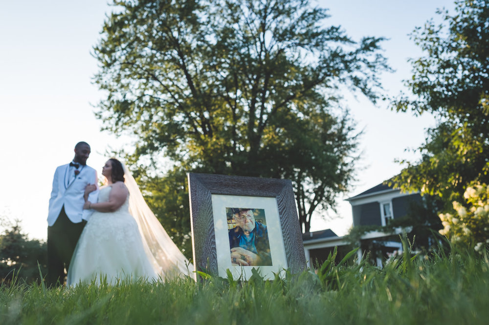 bride-groom-with-photo-of-passed-grandpa