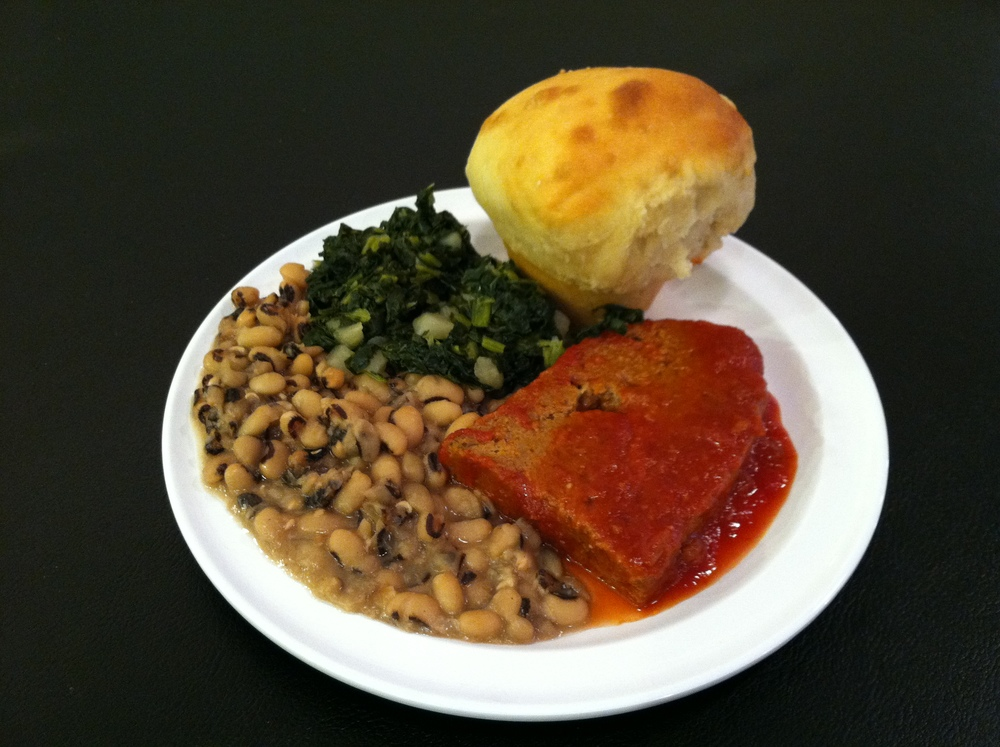 Mama's Meatloaf with creole sauce, black-eyed peas, and turnips 'n' greens
