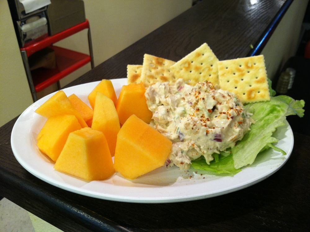 Chicken salad with a side of cantaloupe