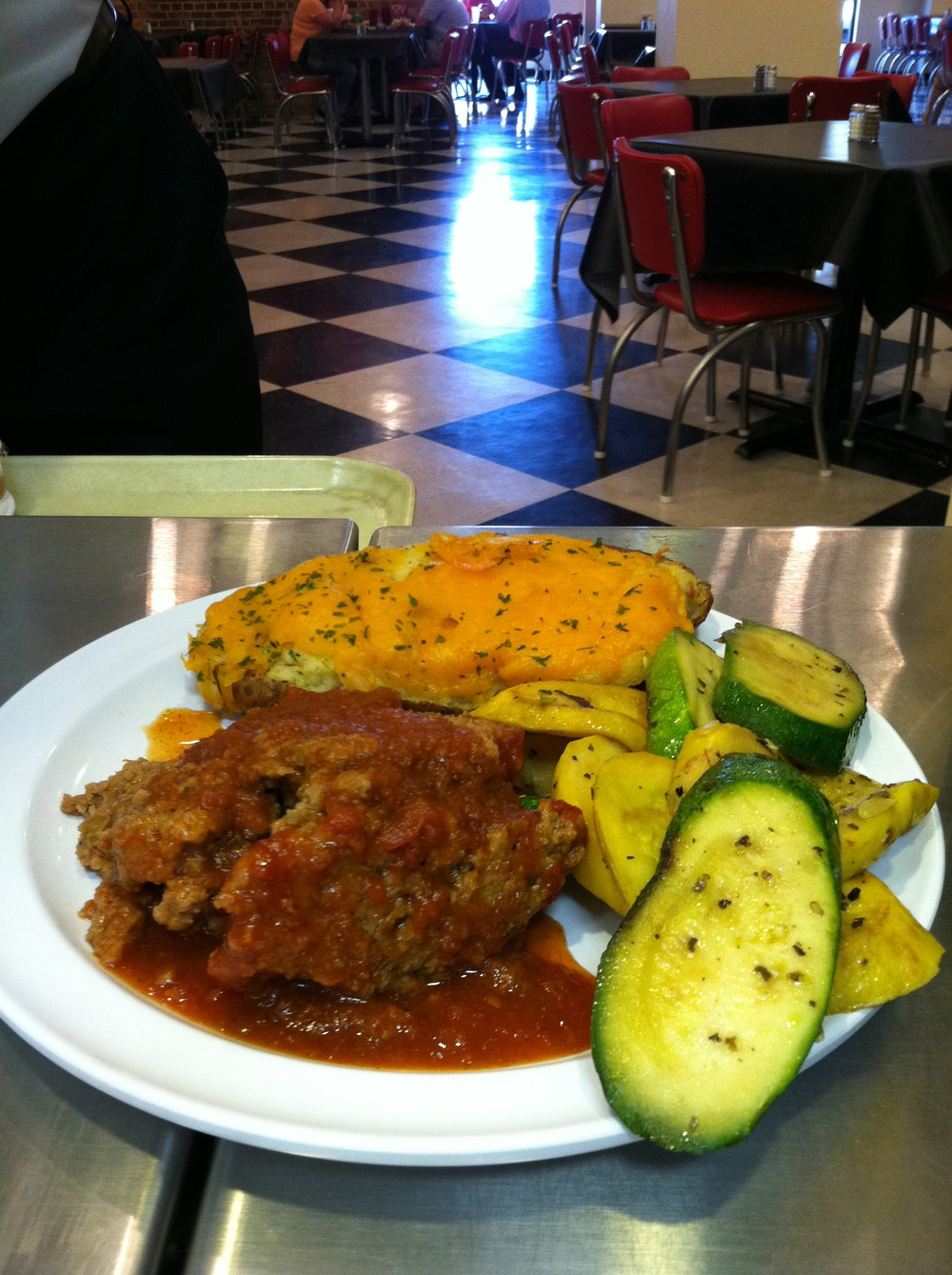 Meatloaf with creole sauce, squash and zucchini and a twice-baked potato