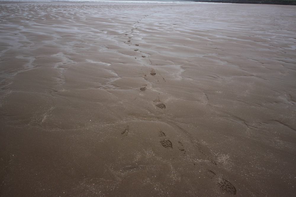 footsteps on woolacombe beach