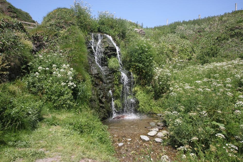 waterfall above lansallos beach