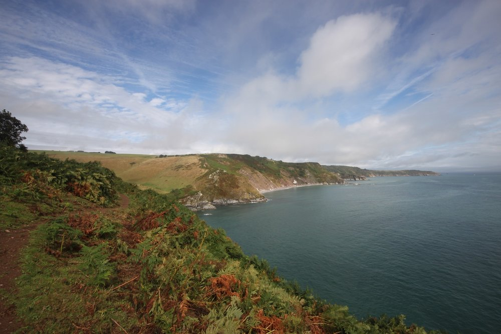 blue skies over scabbacombe and man sands