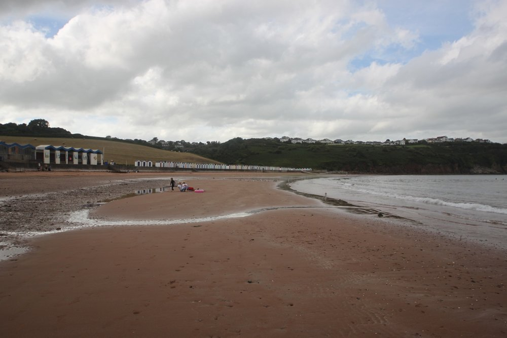 colourful beach huts at broadsands